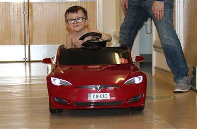 Mini Tesla car donated to Children's Ward at Cumberland Infirmary